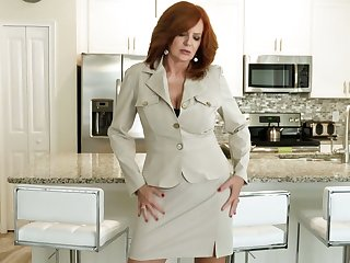 Red haired cougar Andi James is playing with will not hear of aged jugs together with stretched twat